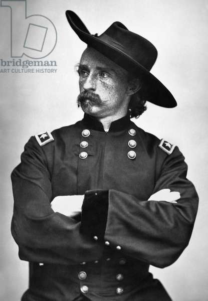 GEORGE CUSTER (1839-1876) American army officer. Photographed during the Civil War in the uniform of a Union Army major general.