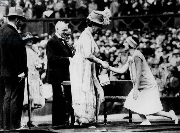 Queen Mary of England awarding French tennis player Suzanne Lenglen (1899-1938) for 50th anniversary of Wimbledon Championship 1923