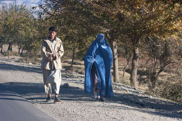 Man and Woman Wearing A Burqa in Charikar, Parwan Province, Afghanistan (photo)