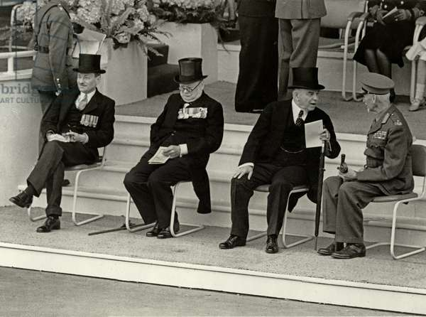 Empire Statesmen wait for the march-past, Clement Attlee and Sir Winston Churchill at the London Victory Celebrations, 8th June 1946 (b/w photo)