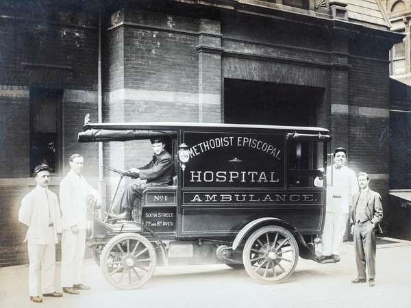 Four Attendants and a Doctor Pose with Methodist Episcopal Hospital Motor Ambulance, Brooklyn NY, Brooklyn NY, c.1910 (silver gelatin print)