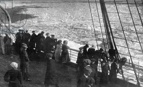 ATLANTIC OCEAN, 1912 Passengers on a steamship in the Atlantic Ocean looking out onto a field of ice, a similar view as would have been visible to passengers on the 'Titanic.' Photograph, 1912.