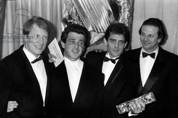 """Les Trois Hommes du Film """"Trois Hommes Et Un Couffin"""", Cesar Of Best French Film, In The Company Of The Producer: From Left To Right: Andre Dussolier, Michel Boujenah, The Producer Of The Film: Jean-Francois Lepetit And Roland Giraud February 22, 1986. Neg: Cx18572 (b/w photo)"""