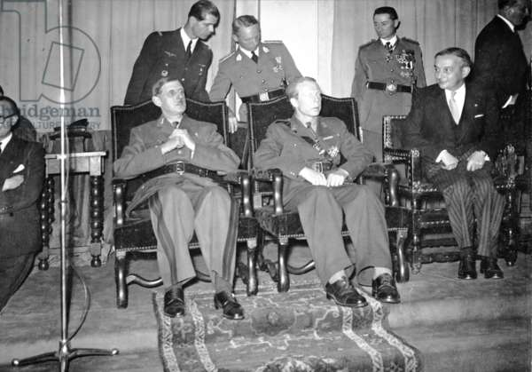 General de Gaulle awarded the title of Honorary Citizen of Brussels, with Prince Charles of Belgium and Georges Bidault, University of Brussels, 11 October 1945 (b/w photo)
