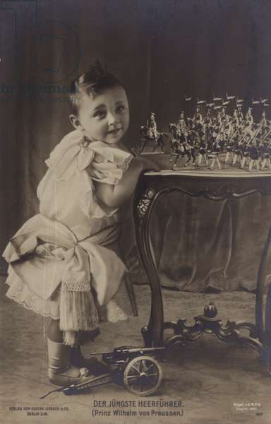 The youngest army commander: Prince Wilhelm of Prussia, son of Crown Prince Wilhelm of Germany, playing with toy soldiers, 1900s (b/w photo)