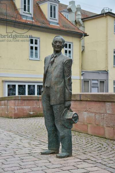 Life-size statue of the poet Hermann Hesse on the Nicholas Bridge in Calw, Germany (photo)