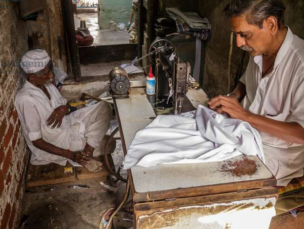 A Hindu tailor works at his sewing machine in the village of Napa where Mahatma Ghandi passed through during his Salt March (photo)