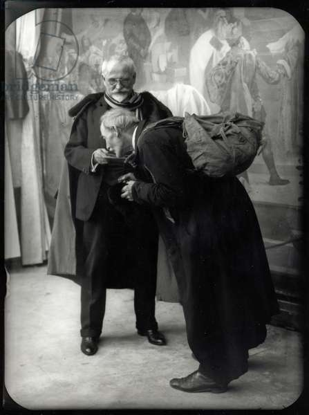 Mucha and his assistant Knap posing for 'The Holy Mount Athos' (The Slav Epic cycle No.17, 1926), c.1925-26 (b/w photo)