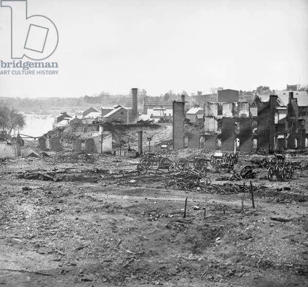 CIVIL WAR: RICHMOND, 1865 Guns and ruins near the Tredegar Iron Works at Richmond, Virginia following the American Civil War. Photograph, April 1865.