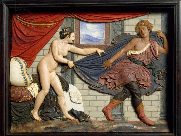 Joseph flees Potiphar's wife, wax tile