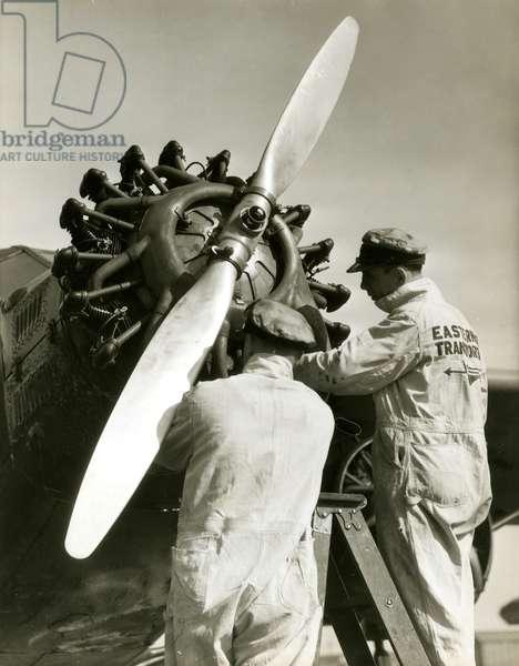 Mechanics fix plane prop, USA, c.1920-38 (gelatin silver photo)