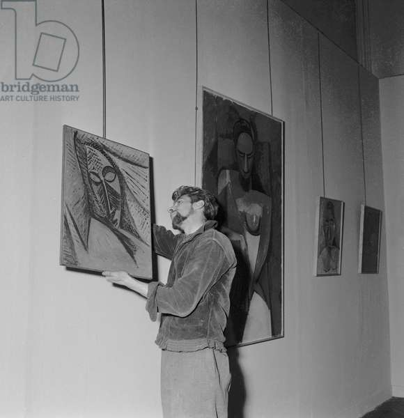 Final arrangements before the exhibition of Pablo Picasso's artwork among which 'Head of a Sleeping Woman' at the Maison de la Pensee francaise in Paris, on June 8, 1964
