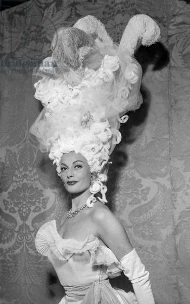 The beauty salon in Paris, October 5, 1950 : Maggy Sarragne with an hairstyle by Antonio, wearing a Lanvin dress (b/w photo)