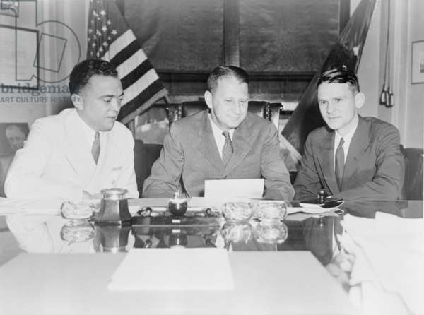 FBI Director J. Edgar Hoover and William Stanley, in a Justice Department meeting with Melvin H. Purvis, head of the Chicago FBI office. Purvis was personally reporting to Hoover about the killing of John Dillinger during his capture by the Special Agents on July 22, 1934