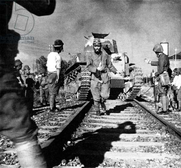 China: Imperial Japanese troops guiding a tank across the Shanghai-Nanking (Nanjing) railway line, 1937
