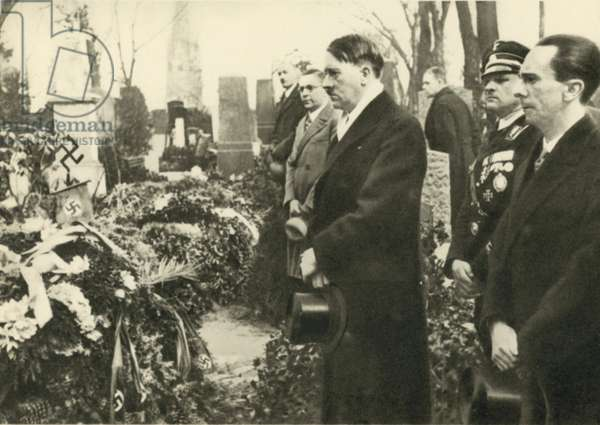 Nazi leaders Adolf Hitler and Joseph Goebbels visiting the graves of Nazis at the cemetery of Luisenstadt, Berlin, before the opening of the Reichstag on 21 March 1933 (b/w photo)