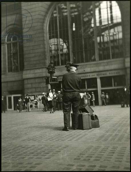 Penn Station, 7th Avenue: Porter watching luggage, USA, c.1920-38 (gelatin silver photo)