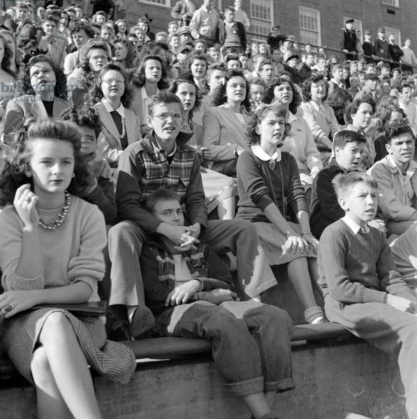 HIGH SCHOOL, 1943 High schoolers watching the football game at Woodrow Wilson High School in Washington, D.C. Photograph by Esther Bubley, 1943.