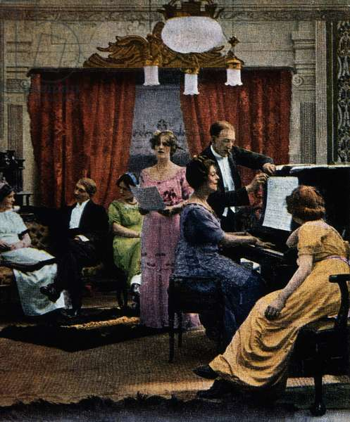 Woman singing with piano accompaniment in the parlor, c.1900 (coloured photo)