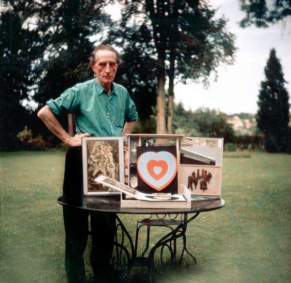 Marcel Duchamp with a box containing samples of his work, c.1957 (photo)