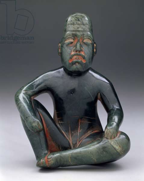Seated figure with upraised knee, Highland Olmec, San Martin Texmelucan, (serpentine & cinnabar)