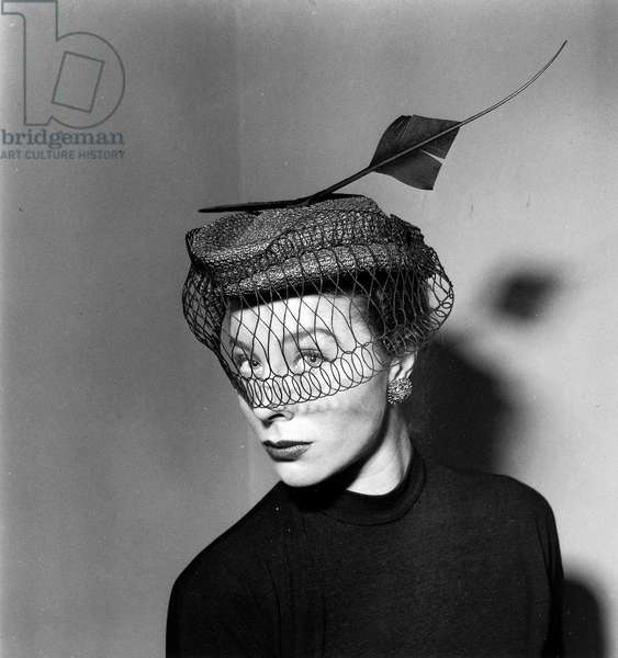 Bettina Graziani modelling a hat by Rose Valois, 1951 (b/w photo)