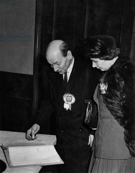 General Election 1950. Mr. and Mrs. Clement Attlee looking through the voters' list as the polls closed at Walthamstow tonight.