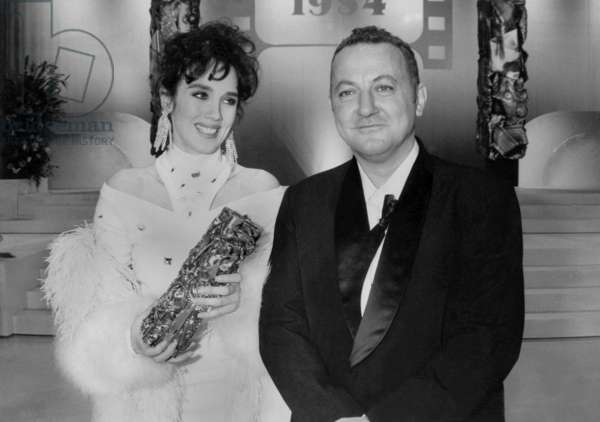 French Actors Isabelle Adjani, With French Movie Prize, and Coluche on March 5, 1984 (b/w photo)