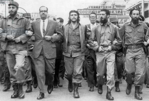 Cuba: 5 March 1960: Memorial service march for victims of the La Coubre explosion in Havana. On the far left of the photo is Fidel Castro, while in the center is Che Guevara.