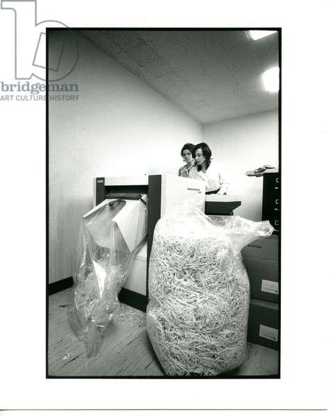 Two unidentified C.R.P. employees feeding the shredding machine at the C.R.P. headquarters, 29th June, 1972 (b/w photo)