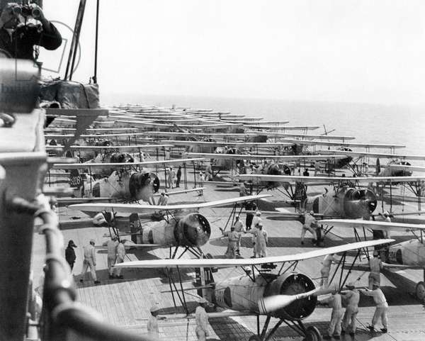 Japan: Imperial Japanese Navy aircraft carrier 'Kaga' conducts air operations in 1937. On the deck are Mitsubishi B2M Type 89, Nakajima A2N Type 90, and Aichi D1A1 Type 94 aircraft, 11 May 1937