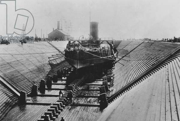 Naval monitor Puritan docked for official test, 1889 (b/w photo)