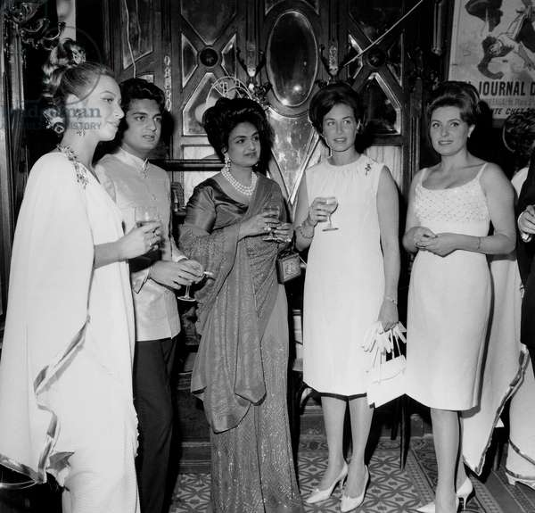 Party Given at Vagenende Restaurant in Paris : Maharani of Baroda Who Has The Most Beautiful Jewels in Paris and the Jeweller Irene Jacob June 17, 1966 (b/w photo)