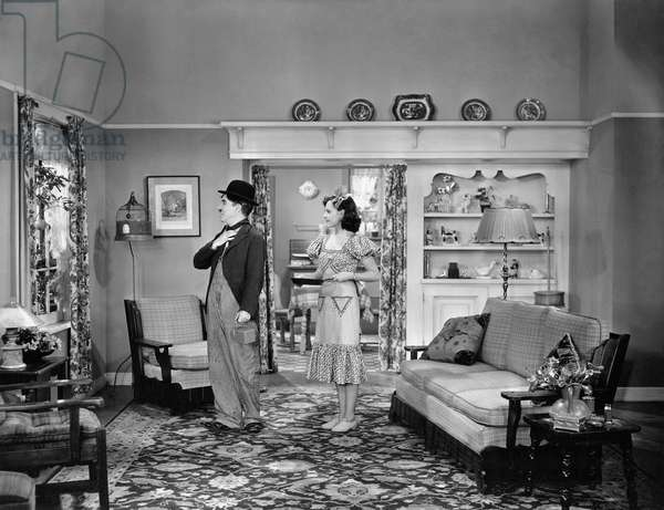 1936: British Comedian And Director Charles Chaplin (1889 - 1977) And Actress Paulette Goddard (1911 - 1990), To Whom He Was Married For Seven Years, Star In The Comedy 'Modern Times'. Chaplin Directed The Movie As Well As Starring In It. Title: Modern Times Studio: Charles Chaplin Director: Charles Chaplin (Photo By Max Munn Autrey)