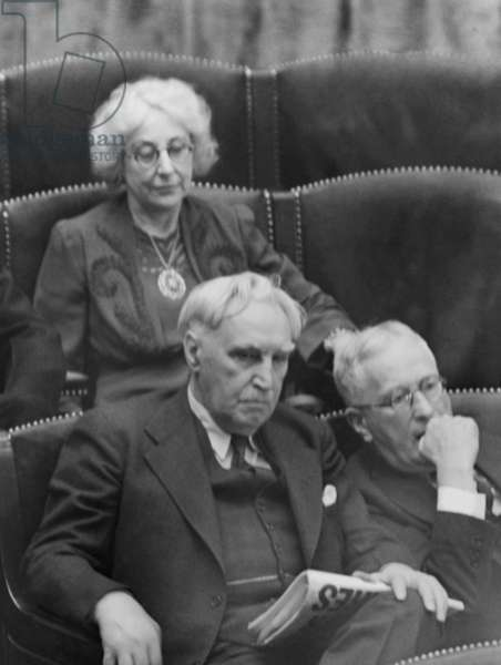 Rep. Jeannette Rankin of Montana, in House during Resolution of War Declaration on Germany and Italy. Dec. 11, 1941. She was only one in Congress who abstained from the vote. Seated in front are Rep. Charles Easton of New Jersey and John Tabor of New York