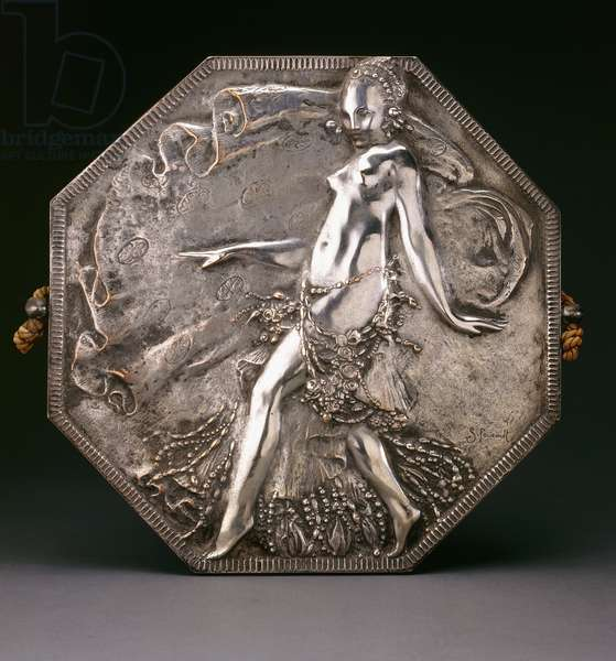 A silvered bronze plaque depicting a partially nude maiden in a beaded skirt (silvered bronze)