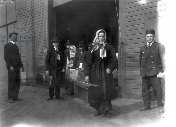 ELLIS ISLAND, 1900 Immigrants leaving Ellis Island, c.1900.