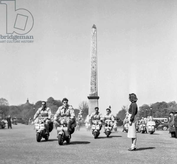 Start of the scooter raid between Paris and Tibet, here in Paris on April 16, 1951 : l-r : Yves Ponzy, Guy Camba, Michel Leclerc and Pierre Palmieri (b/w photo)