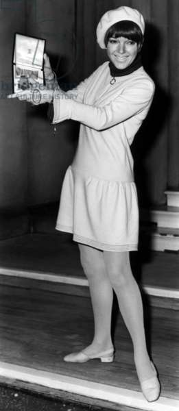 Mary Quant holding her Order of the British Empire medal, 1966