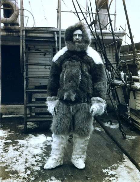 "Robert E. Peary (1856-1920) Arctic explorer wearing fur clothing on the deck of his ship, ""Roosevelt."" 1905 expedition"