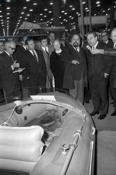 Opening of the Yachting Festival in Paris, January 8, 1970 : Alain Bombard showing his dinghy to Joseph Comiti (b/w photo)