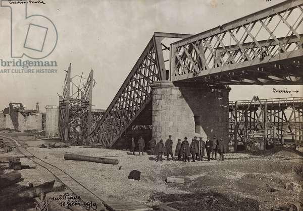 """Italo Austrian War 1915-1918"": rubble of a bombed bridge over the Piave, 18/02/1919 (b/w photo)"