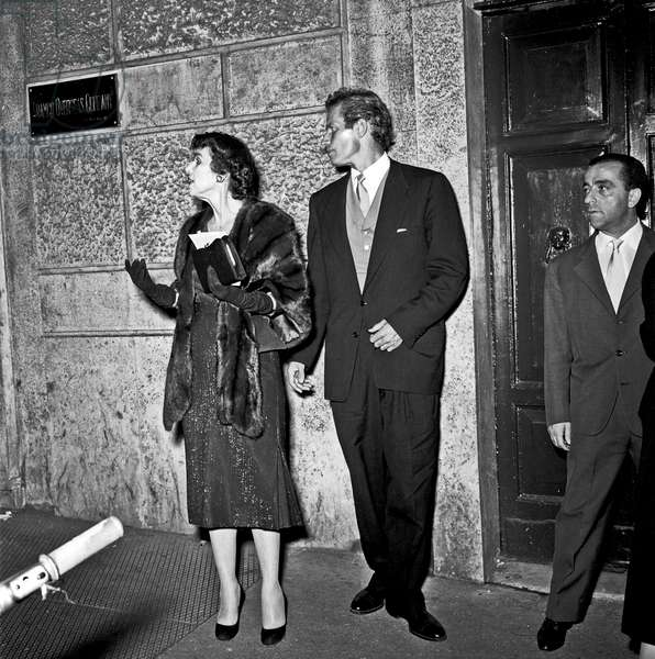 Charlton Heston leaving teatro Sistina with his mother Lila Charlton, Rome, Italy, 1958 (b/w photo)