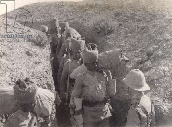 Indian troops passing through a trench on the Mesopotamian Front, 1917 (b/w photo)