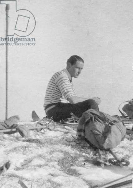 Paul-Emile Victor, during a ski hike, takes a break at the Croix des 7 Brothers, La Poya, Morillon, Haute-Savoie, France, December 1932 (b/w photo)