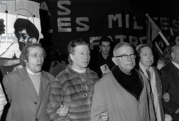 Simone de Beauvoir and Jean-Paul Sartre during a demonstration to protest against the murder of Pierre Overney,  in Paris, 29th February 1972 (b/w photo)