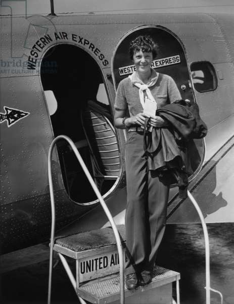 Amelia Earhart 1897-1937 standing in the door of a Western Airlines planes in California as she embarks to New York to make her first New York first public appearance at Carnegie Hall. 1930s