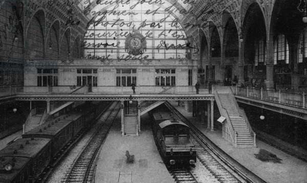 Interior of Orsay station in Paris, former station of the Compagnie du Chemin de fer d'Orleans, Paris. Designed by french architect Victor Laloux (1850-1937). Postcard, c. 1904