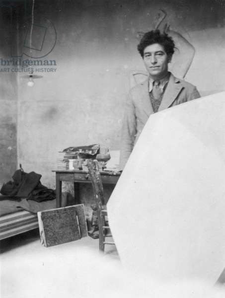 Alberto Giacometti in his studio with the plaster sculpture 'Cube', c.1933 (b/w photo)