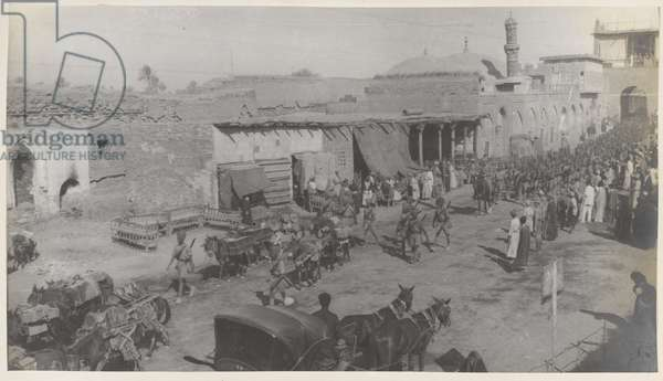 Indian troops and pack mule transport marching through New Street, Baghdad, 1917 (b/w photo)